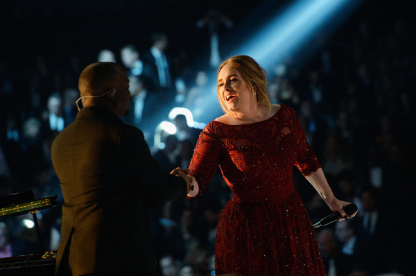 Eric Wortham shaking hands with Adele after a performance.
